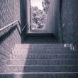 Vintage like photo from a stairway with red and handrail — Stock Photo #37953289