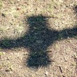 Stock Photo: Shadow of a cross on dirty floor
