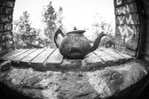 Fish eye close up of a very old rusty tea pot — Stockfoto