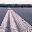 Worms eye vintage shoot of a road marking on an airstrip — Stock Photo