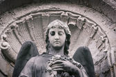 Vintage close up of an angel sculpture — Stock Photo