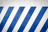 Blue diagonal stripes on a white wall — Stock Photo