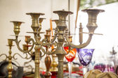 Old candle stand out of brass on a flea market — Stock Photo