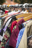 Clothes on a rack on a flea market — Stock Photo