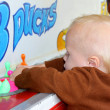 Baby Playing Carnival Duck Game — Stock Photo #31648645