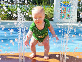 Baby Playing in Water Park — Stock Photo