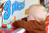 Baby Playing Carnival Duck Game — Stock Photo