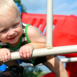 Stock Photo: Happy Baby Playing at Playground
