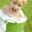 Child in Bubbly Wash Basin — Stockfoto