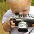 Baby Boy Playing with Vintage Camera — Stock Photo