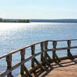 Stock Photo: Old Pier on Glistening Lake