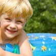 Happy Child in Baby Swimming Pool — Stock Photo