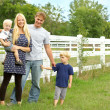 Happy Family Outside by Horse Pasture — Stock Photo #31652583