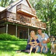 Stock Photo: Happy Family and Dog by House