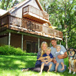 Happy Family and Dog by House — Stockfoto