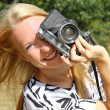 Stock Photo: Happy Womwith Vintage Camera