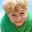 Stock Photo: Happy Boy in Beach Towel