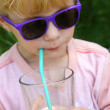 Stock Photo: Child in Sunglasses Drinking Chocolate Milk