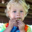 Little Child Eating Chocolate Cookie — Stock Photo