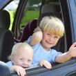Children Smiling Out VWindow — Stock Photo #31655119