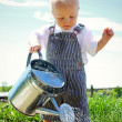 Baby Watering the Sidewalk with Tin Water Can — Stock Photo