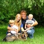 Happy Family Sitting Under Willow Tree — Stock Photo