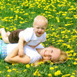Mother and Baby Laying in Dandelions — Stock Photo
