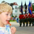 Child Eating Candy at Parade — Stock Photo