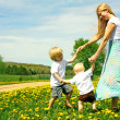 Mother and Children Playing Outside — Stock Photo