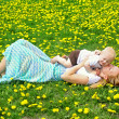Mother Kissing Baby in Dandelion Field — Stock Photo #31658685