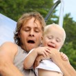 Father and Baby Sliding at Playground — Stock Photo