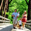 Family Walking Across Bridge — Stock Photo