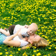 Young Mother Kissing Baby in Meadow — Stock Photo
