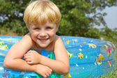 Happy Child in Baby Pool — Stock Photo