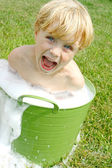 Child in Bubbly Wash Basin — Stock Photo