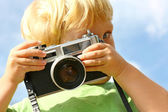 Child Taking Picture with Vintage Camera — Stock Photo