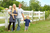 Happy Family Outside by Horse Pasture — Stock Photo