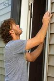 Carpenter Fixing Door — Stock Photo