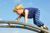 Happy Child Climbing at Playground in Front of Blue Summer Sky — Stock Photo