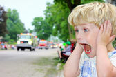 Child Covering Ears at Loud Parade — Stock Photo