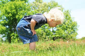 Little Boy looking at Somehing in the Grass — Stock Photo
