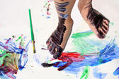 Painted Kid's Feet on Art Project — Stock Photo