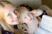 Woman Reading with Baby on her Lap — Stock fotografie