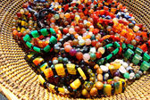 Colorful Beads in Woven Basket — Stock Photo