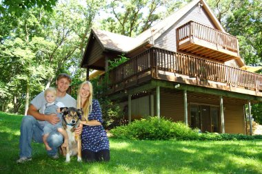 Happy Family and Dog by House