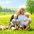 Happy Family Outside in Dandelions — Stock Photo