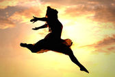Woman Leaping at Sunset — Stock Photo