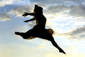 Woman Silhouette Leaping — Stock Photo