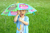 Child Trapped in Rain Storm with Umbrella — Stock Photo
