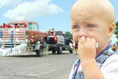 Baby Eating Candy at Parade — Stock Photo